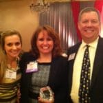 Geri Pacheco (winner) with Laura Koch and Jim Wilkinson of SCFO